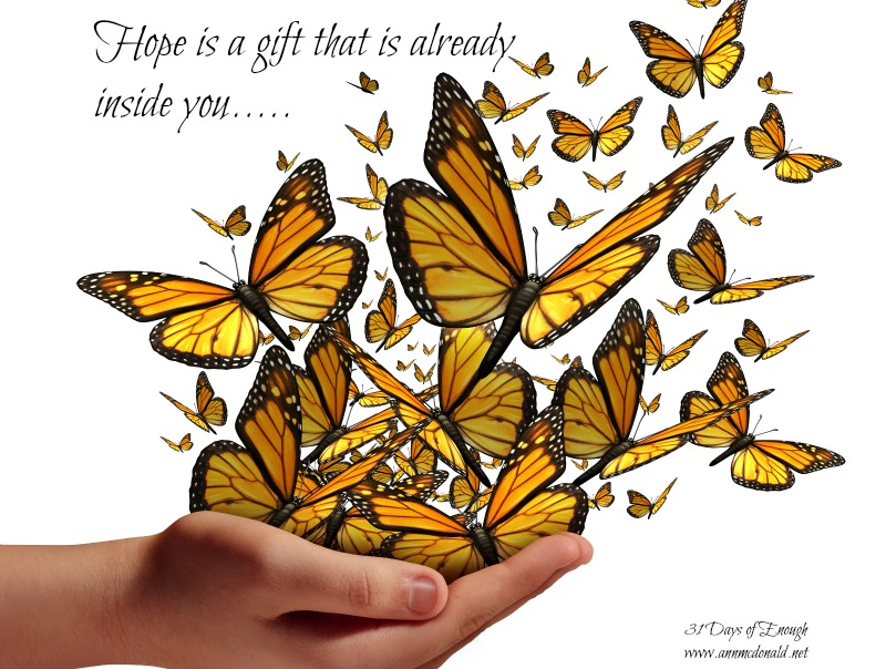 Hope and freedom concept as a human hand releasing a group of butterflies as a symbol for educationcommunication and spreading ideas with social marketing isolated on a white background.